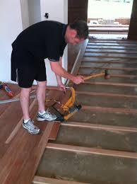 How To Install Laminate Wood Flooring On Concrete Slab Install Hardwood Floor Hardwood Double Border On Hardwood Floor