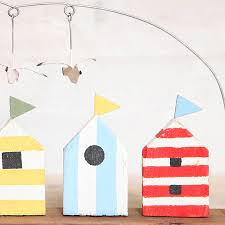 huts and seagull ornament by berry apple