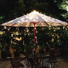 solar powered umbrella lights add brilliant beautiful illumination to your outdoor umbrella with