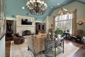 living room with painted high ceiling and chandelier painting