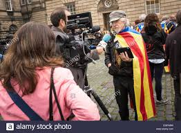 a television crew conduct an interview during a catalan stock