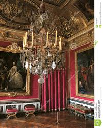 versailles chandelier red room with large paintings and chandelier at versailles palace