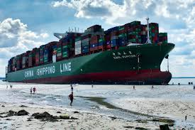 large containership runs aground on scheldt river near antwerp