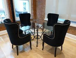 awesome black wing back dining chair with round glass dining table