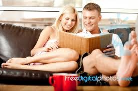 Couple Photo Album Couple Looking At Photo Album Stock Photo Royalty Free Image Id