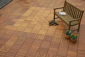 ipe wood deck tiles covering a drab asphalt surface on a garage