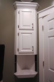 Sliding Door Bathroom Cabinet White Floating White Wooden Cabinet With Triangle Shape Plus Two Storage