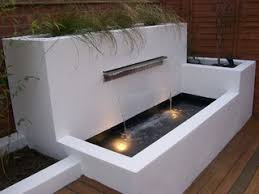 modern water feature modern water feature which adds height and structure to garden