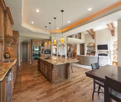 open concept layout family room rustic with vaulted ceiling