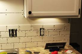 how to install a subway tile kitchen backsplash row by row tiles