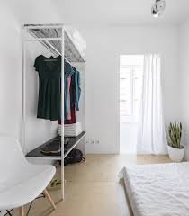 in lisbon a narrow but glamorous marble clad apartment remodelista