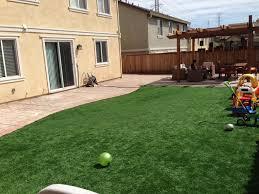 installing of artificial grass backyard aroi design