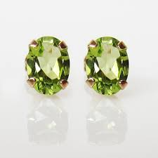peridot stud earrings oval peridot stud earrings in 10k yellow gold august birthstone