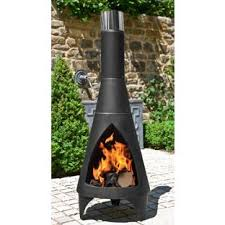 Steel Chiminea Extend Your Patio Life Six Fire Pits To Cozy Up To This Fall
