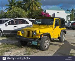 jeep yellow dh wrangler jeep tortola caribbean yellow jeep wrangler x tj stock