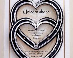 heart shaped horseshoes entwined heart shaped horseshoes unicorn shoes