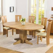 solid oak round dining table 6 chairs monty solid oak extending round dining table with 6 arley chairs
