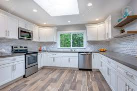 pics of kitchens with white cabinets and gray walls open concept kitchen with white cabinets grey quartz countertops