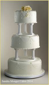 cake pillars classic pillar wedding cake with piped swags and flowers
