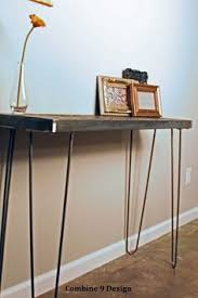 live edge walnut top console sofa table with handmade raw steel