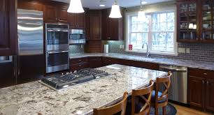 Cherry Kitchen Cabinets With Granite Countertops by Bianco Antico Granite Countertops Fabricated And Installed By