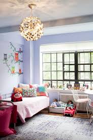 photos hgtv girls bedroom with lavender walls pinwheel globe photos hgtv girls bedroom with lavender walls pinwheel globe chandelier and owl wall mural