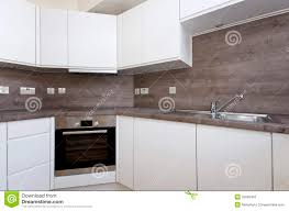 Modern Kitchen Tiles by Contemporary Kitchen With Natural Stone Worktop And Tiles In Whi