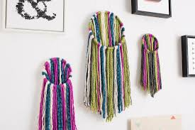 this diy wall hanging is the best way to use yarn in the summer