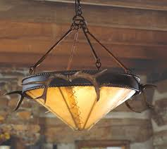 iron chandelier w antlers rawhide western decorwestern styleiron chandeliersrustic lightingantlershome ideaswesternsironsmountain