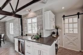 Herringbone Tile Floor Kitchen - contemporary kitchen with flat panel cabinets u0026 sliding barn door