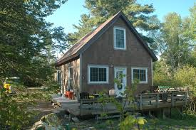 lakeside cottage plans signature exterior front elevation plan
