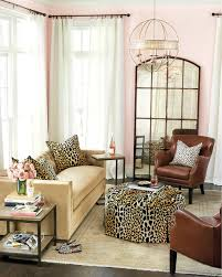 15 ways to layout your living room how to decorate shop amiel arch aged brown antiqued mirror dixon leather chair hayes ottoman ballard designs durham rectangle end table durham tray table and more