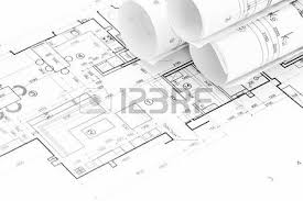 architect floor plans architect workspace with rolled floor plans and blueprints stock