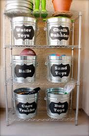 use galvanized tubs to organize small outside toys organize