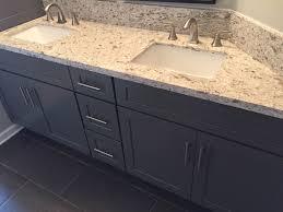 dark grey shaker bathroom cabinets with quartz countertops for