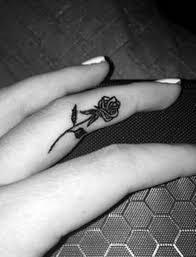 33 beautiful rose finger tattoos