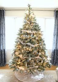 lightly flocked christmas tree diy flocked tree easier than it seems all the details artsy