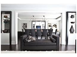 high ceiling curved sofa double height columns étagère art gray