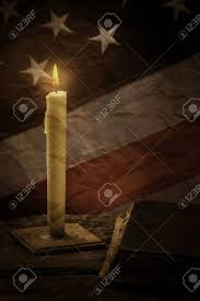 American Flag Burning Book And Old American Flag Burning Candle Beside A Book True