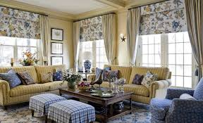 blue and brown floral curtains tan living room with red accents