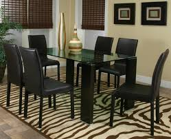 rectangle black glass dining table with black wooden legs added by