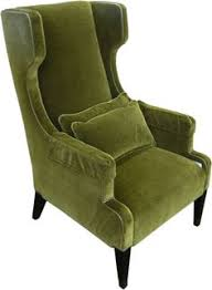 yellow tufted leather wingback chair with wood frame on wooden