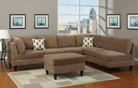 grey walls brown sofa brown sofa with cushions bench table white carpet on wooden laminate