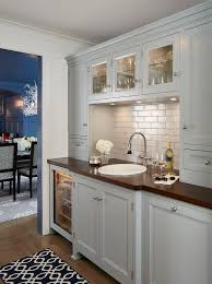 light grey kitchen cabinets with wood countertops light gray butler pantry with wood countertop transitional