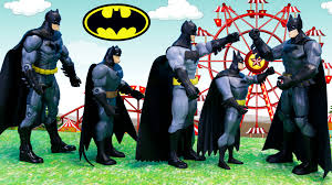 batman costumes batman convention with superman saving different people wearing