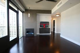 charming design of dark hardwood floors for spacious room with