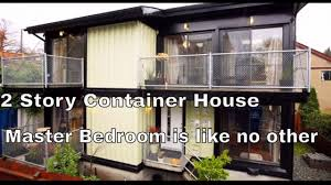 enter a spectacular 2 story container house the oversized master
