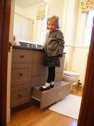 built in vanity stool for kids to reach the sink home decor