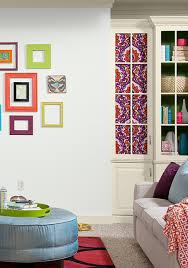 white walls with bright home decor make for an eclectic and fun