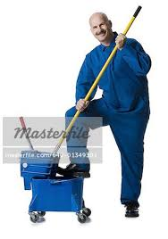 janitor jumpsuit portrait of a janitor holding a mop stock photo